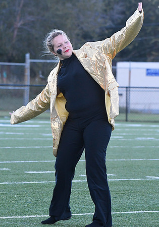 Hennessey flag guard member, Alexis Brim, during the Hennessey High School marching band's performance in the Tri-State Marching contest Tuesday October 4, 2016. (Billy Hefton / Enid News & Eagle)