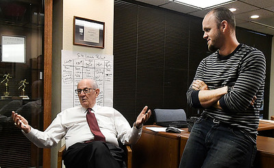Dean Henderson, managing partner of Biz Warriors (left) and Jared McClellan, marketing and creative director, during an interview Thursday October 13, 2016. (Billy Hefton / Enid News & Eagle)