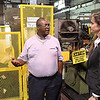 Punch-Lok general manager, Barry Robinson, talks about safety precautions with Oklahoma Labor Commissioner, Melissa Houston, following a ceremony where the company was presented with a SHARP (Safety & Health Achievement Recognition Program) AwardWednesday October 12, 2016. (Billy Hefton / Enid News & Eagle)