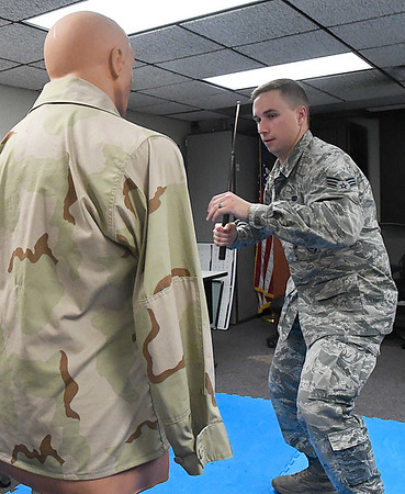 Senior Airman Carson Gorman does a demonstration with a baton Friday October 14, 2016 at Vance Air Force Base. (Billy Hefton / Enid News & Eagle)
