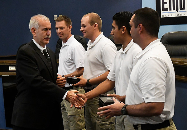 Enid police chief Brian O'Rourke shakes the hands of the newest Enid police officers, Andrew Ash, Austin Lenamond, Ryan Rios and Bradley Davis Thursday October 5, 2017. (Billy Hefton / Enid News & Eagle)