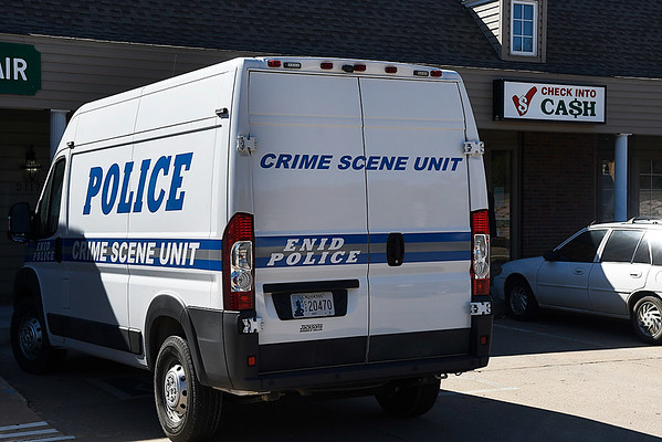 The Enid police department crime scene unit sits outside Check into Cash after it was robbed Wednesday October 25, 2017. (Billy Hefton / Enid News & Eagle)