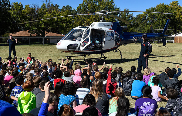 Medi Flight paramedic, Mark Hopping, answers question during a school assembly at Hoover Elementary Wednesday October 25, 2017. (Billy Hefton / Enid News & Eagle)