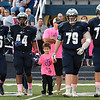 Gunner Williams walks out with Enid High captains, Aryian Levy, Ivey Mace, Colton Dodd and Austin Whitehead, for the coin toss prior to the game against Lawton at D. Bruce Selby Stadium Friday October 13, 2017. (Billy Hefton / Enid News & Eagle)
