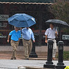 A trio of men cross Independence street in the rain Wednesday October 4, 2017. (Billy Hefton / Enid News & Eagle)