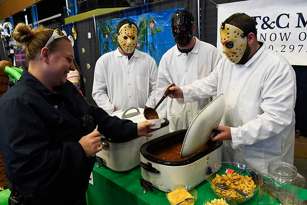 (left to right) Zach Hill, Eldon Campbell and Tyler Tate from T&C Meats serves chili during the 30th United Way Chili Cookoff Friday October 27, 2017 at the Central National Bank Center. (Billy Hefton / Enid News & Eagle)