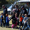 Medi Flight 5 crew members, (left to right) Jim Wagstaff, pilot, Michelle Humphrey, nurse and Mark Hopping, paramedic, shake hands with students at Hoover Elementary following a school assembly Wednesday October 25, 2017. (Billy Hefton / Enid News & Eagle)