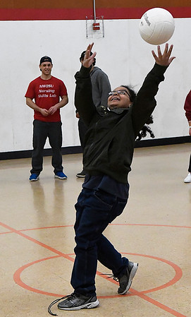 Robert Molette tries to catch the ball during the Name Game while taking part in the Vertical after school program at Longfellow Middle School Monday October 30, 2017. (Billy Hefton / Enid News & Eagle)