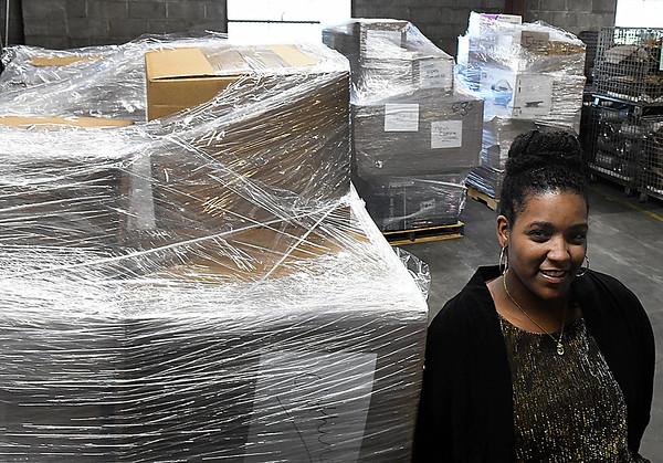 ALicia Belardo stands with donated items that will be sent to the U.S. Virgin Islands as part of a hurrican relief effort. (Billy Hefton / Enid News & Eagle)