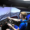 Mike Caddell watches Tobias Schmidt drive the truck simulator during Manufactoring Day at Aurty Technology Center in conjuction with the school's 50th anniversary. (Billy Hefton / Enid News & Eagle)