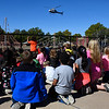 Students at Hoover Elementary watch as a Medi Flight helicopter lands on the playground for a school assembly Wednesday October 25, 2017. (Billy Hefton / Enid News & Eagle)
