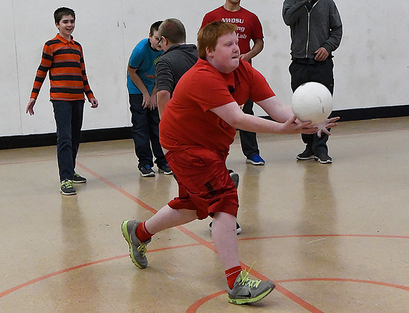 Justin Prather catches the ball during the Name Game while taking part in the Vertical after school program at Longfellow Middle School Monday October 30, 2017. (Billy Hefton / Enid News & Eagle)