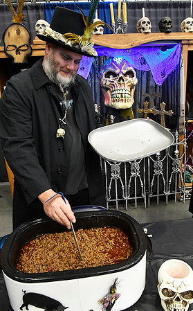 Ronny Petty from Smoke Wagon stirs his chili during the 30th United Way Chili Cookoff Friday October 27, 2017 at the Central National Bank Center. (Billy Hefton / Enid News & Eagle)