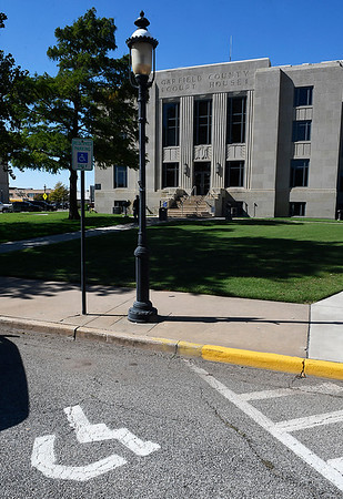 Handicapped parking space on the eastside of the Garfield County Courthouse Wednesday October 11, 2017. (Billy Hefton / Enid News & Eagle)