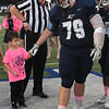Gunner Williams gets a fist bump from Colton Dodd following the coin toss prior to the game against Lawton at D. Bruce Selby Stadium Friday October 13, 2017. (Billy Hefton / Enid News & Eagle)