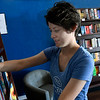 Chloe Fuksa checks a bookshelf during the grand opening for Putnam Six Bookstore Monday October 22, 2018 in Sunset Plaza. (Billy Hefton / Enid News & Eagle)