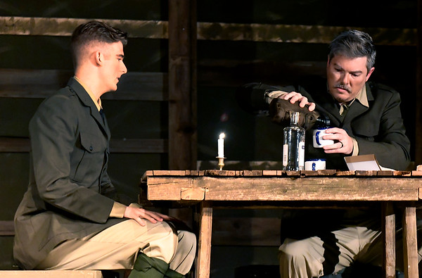 """Alex Ewald and Mitch Lyon rehearse a scene from the Gaslight Theatre production of """"Journey's End"""" Wednesday October 17, 2018. (Billy Hefton / Enid News & Eagle)"""