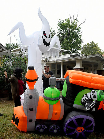 Jeremy and Jennifer Hildebrand set up inflatable Halloween decorations on west Cherokee Thursday October 4, 2018. (Billy Hefton / Enid News & Eagle)