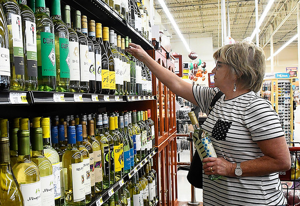 Kay Schuman shops the wine selection Monday October 1, 2018 at Jumbo's West. October 1 was the first day grocery and convenience stores could legally sell wine and strong beer. (Billy Hefton / Enid News & Eagle)