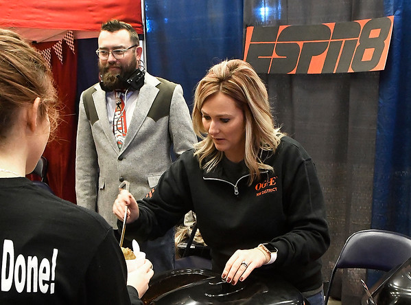 "Sara Scott and Brian Kaiser at OG&E's ""ESPN Ocho"" booth during the United Way Chili Cookoff Friday October 26, 2018 at the Central National Bank Center. (Billy Hefton / Enid News & Eagle)"