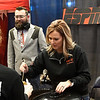 """Sara Scott and Brian Kaiser at OG&E's """"ESPN Ocho"""" booth during the United Way Chili Cookoff Friday October 26, 2018 at the Central National Bank Center. (Billy Hefton / Enid News & Eagle)"""