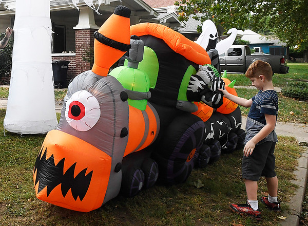 Jax Hildebrand inspects an inflatable Halloween decoration set up by his parents, Jeremy and Jennifer Hildebrand, on west Cherokee Thursday October 4, 2018. (Billy Hefton / Enid News & Eagle)