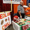 Julio Heng and Terri King serve Bedlam Chili at the United Way Chili Cookoff Friday October 26, 2018 at the Central National Bank Center. (Billy Hefton / Enid News & Eagle)
