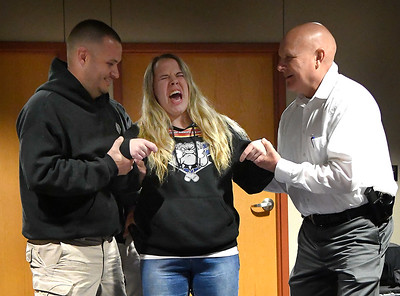 Officer Robert Elliott and Capt. Gary Fuxa support Faith Odom while is tased during the Enid Police Department's Citizens Police Academy Tuesday October 30, 2018. (Billy Hefton / Enid News & Eagle)