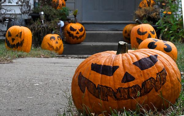 An abundance of pumpkins line the walk to a house on west Oklahoma Thursday October 4, 2018. (Billy Hefton / Enid News & Eagle)