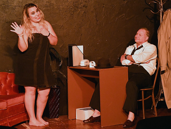 """Ashley McConnell and Jim Clark rehearse the one act play """"Murder by Midnight""""  Monday, October 7, 2019 at the Turpin Theater. (Billy Hefton / Enid News & Eagle)"""
