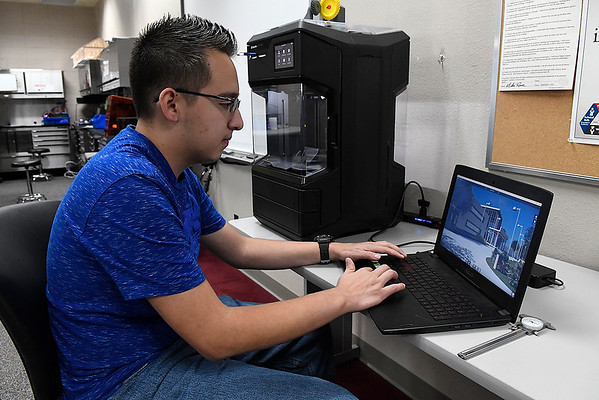 Nicolas Martinez, a senior at Enid High School, works with a 3D printer in the Computer Aided Drafting & Design class at Autry Technoloy Center Monday October 7, 2019. (Billy Hefton / Enid News & Eagle)