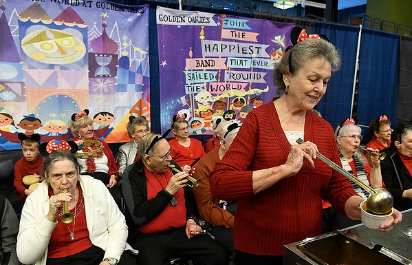 Gladys Nokes serves chili in the Golden Oaks booth as a kazoo band plays behind her during the United Way Chili Cook-off Friday, October 25, 2019 inside the Stride Bank Center. (Billy Hefton / Enid News & Eagle)