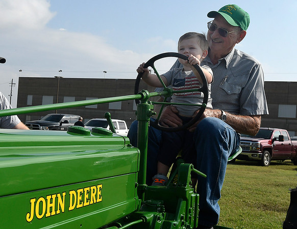 Bill Patocka and his great grandson, Kolt, sit on a 1939 John Deere tractor during the Enid Antique Power Gas Engine & Tractor Show Saturday, October 5, 2019 at the Garfield County Fairgrounds. (Billy Hefton / Enid News & Eagle)