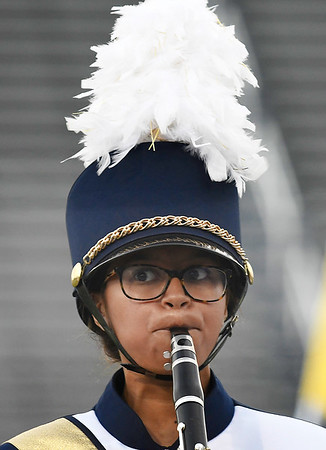 A member of the Kingfisher High School marching band during the Tri-State marching competition Tuesday, October 1, 2019 at D. Bruce Selby Stadium. (Billy Hefton / Enid News & Eagle)