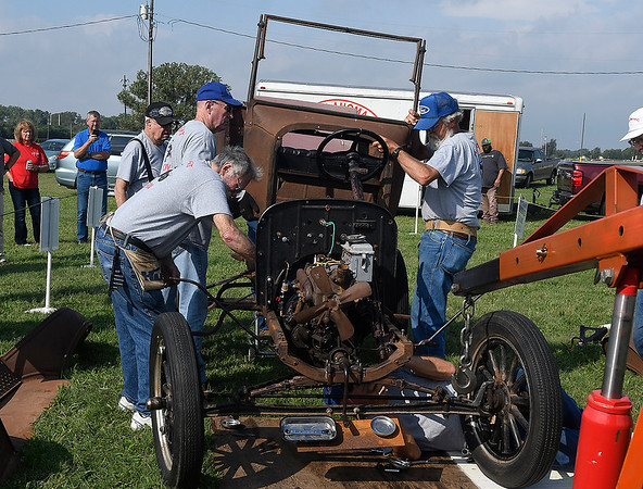 Members of the Oklahoma Special T's Model T Club assemble and start a Model T in just over 8 minutes during the Enid Antique Power Gas Engine & Tractor Show Saturday, October 5, 2019 at the Garfield County Fairgrounds. (Billy Hefton / Enid News & Eagle)