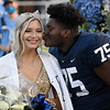 C.J. Adams gives the traditional kiss to homecoming queen, Sydney Quarles, during ceremonies Friday, October 9, 2020. (Billy Hefton / Enid News & Eagle)