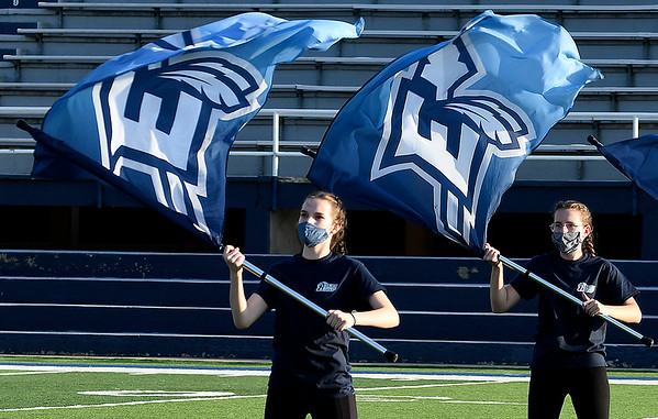 Members of the Enid High School marching band's flag team perform during the Tri-State Marching Contest Tuesday, October 6, 2020 at D. Bruce Selby Stadium. (Billy Hefton / Enid News & Eagle)