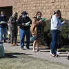 People fill out forms while waiting in line to take advantage of early voting at the Garfield County Election Board. (Billy Hefton / Enid News & Eagle)