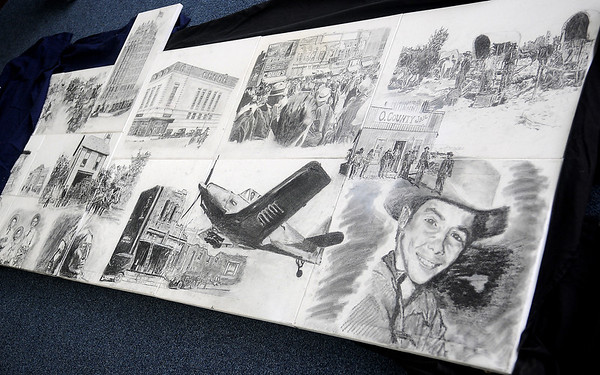 A large mural of his Duron Lewis's sketches will be on display at the Library of Enid and Garfield County as part of the Cherokee Strip Celebration from Friday, Sept. 13-Monday, Sept. 23, 2013, An unveiling of the mural revealed drawings by Lewis that depict historical moments in Enid from 1893 to the present time.  (Staff Photo by BONNIE VCULEK)