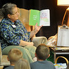 A Garfield County Fair Official Fair Sitter reads a book to the Chisholm pre-K class at the Chisholm Trail Coliseum Friday, Sept. 6, 2013. (Staff Photo by BONNIE VCULEK)