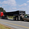 Traffic flows pass the scene of an accident Thursday on US 412 between 30th and 42nd streets involving a passenger car and a tractor trailer. (Staff Photo by BILLY HEFTON)