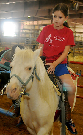 Mira Goldman enjoys a pony ride during the Garfield County Free Fair at the Chisholm Trail Expo Center Saturday, Sept. 7, 2013. (Staff Photo by BONNIE VCULEK)