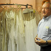 Rev. Jerry Galbreath explains how brides and grooms may select wedding attire for themselves and their wedding party from the University Place Christian Church inventory. The wedding attire may be used for the special day, but cannot leave the church. (Staff Photo by BONNIE VCULEK)