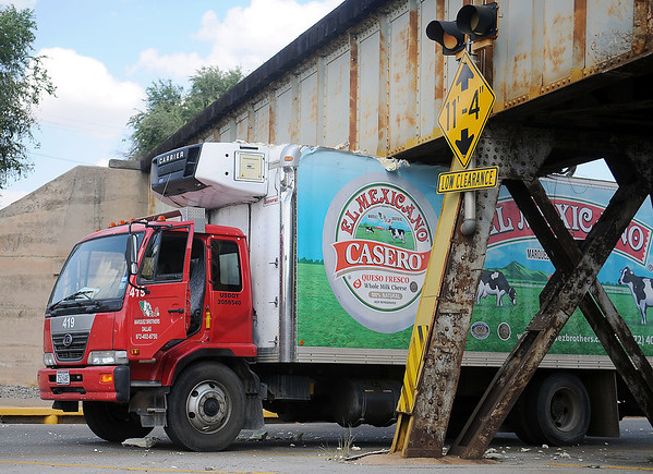 The driver of a Marquez Brothers delivery truck, from Dallas, Tex., peeled the top of the vehicle back after striking the bottom of a train overpass on E. Maine Wednesday, Sept. 11, 2013. (Staff Photo by BONNIE VCULEK)