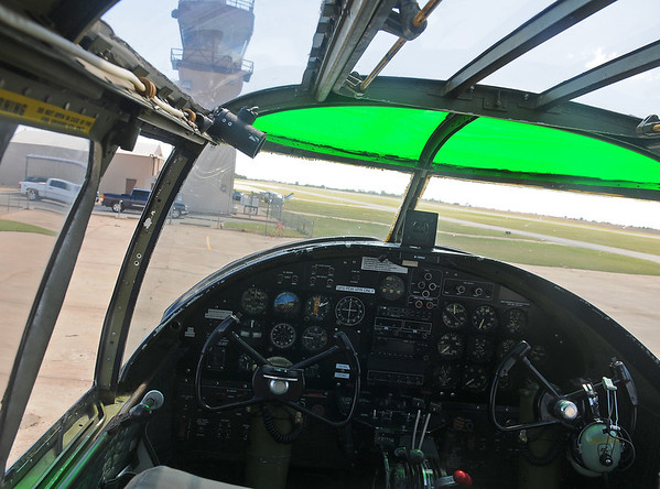 Enid Woodring Regional Airport control tower appears beyond the cockpit glass of the Maid in the Shade B-25 J Monday, Sept. 23, 2013. The World War II Combat Veteran aircraft flew 15 missions with the 57th bomb wing, 391st bomb group, 437th squadron. (Staff Photo by BONNIE VCULEK)