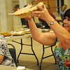 Martha Gabriel (right), a former Extension Home Economist, holds up a cherry pie entry as she judges the category during the Garfield County Fair Friday, Sept. 6, 2013. Linda Sader, food superintendent for the local fair, placed the ribbons on the winning pies. (Staff Photo by BONNIE VCULEK)