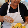 Ramona Walters prepares an Indian taco for guests at the Enid-Intertribal meal on the Garfield County Court House lawn during Cherokee Strip Celebration festivities Friday, Sept. 13, 2013. (Staff Photo by BONNIE VCULEK)