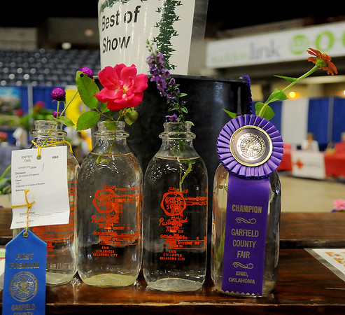 The collection of 4 kinds of flowers, exhibited by Gracie Nunez, placed first and then won the champion ribbon at the Garfield County Free Fair Saturday, Sept. 7, 2013. Nunez, 10, had never been to a county fair exhibited in several categories during this year's event. (Staff Photo by BONNIE VCULEK)