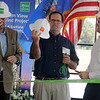 John Kelly (left), with the Alabama Power Corporation, Sen. Patrick Anderson and Brent Kisling, from the Enid Regional Development Alliance, don Enel Green Power safety hats as they prepare for the official ribbon cutting for the Chisholm View Wind Project Wednesday, Sept. 11, 2013. Dignitaries from Italy, across the United States and Oklahoma gathered in Hunter for the dedication of the green power wind turbines in Grant and Garfield  Counties. (Staff Photo by BONNIE VCULEK)