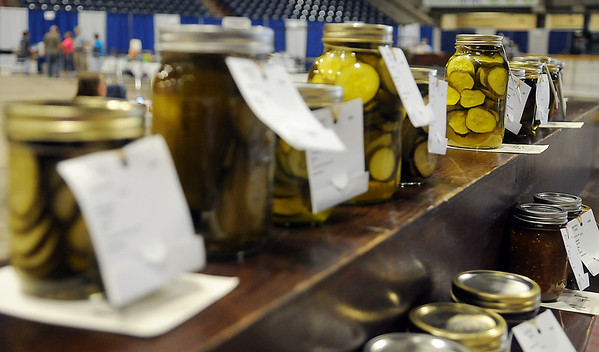 Garfield County Fair canned pickles fill a display shelf as exhibitors deliver their entries Wednesday, Sept. 4, 2013. Judging begins tomorrow morning at the Chisholm Trail Coliseum and Expo Center. (Staff Photo by BONNIE VCULEK)